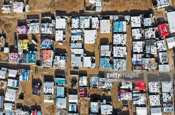 TOPSHOT An aerial view shows an informal tent settlement housing Syrian refugees in the area of Delhamiyeh in the central Bekaa Valley on January 17...