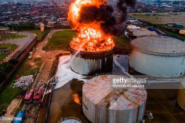 An aerial view shows an oil tanker on fire at the OVH Energy Marketing in Apapa, Lagos, on November 5, 2020. - The cause of the fire is still unknown...