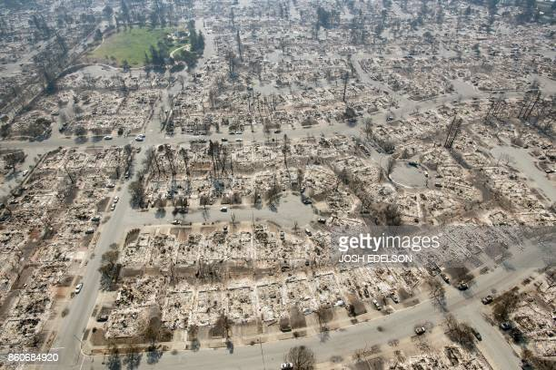 TOPSHOT An aerial view shows burned properties in Santa Rosa California on October 12 2017 Hundreds of people are still missing in massive wildfires...
