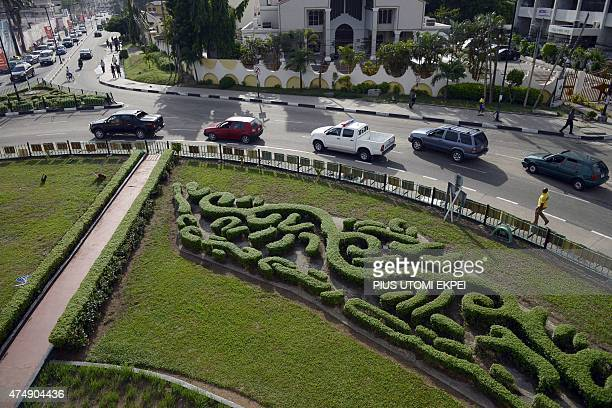 An aerial view shows cars driving past Falomo garden park in Ikoyi district one of the most affluent neighbourhoods of Lagos on May 1 2015 Since the...