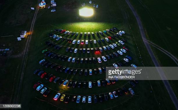 TOPSHOT An aerial view shows cinema goers sitting in their cars parked at a drivein cinema in Marl western Germany on April 6 one of the few...