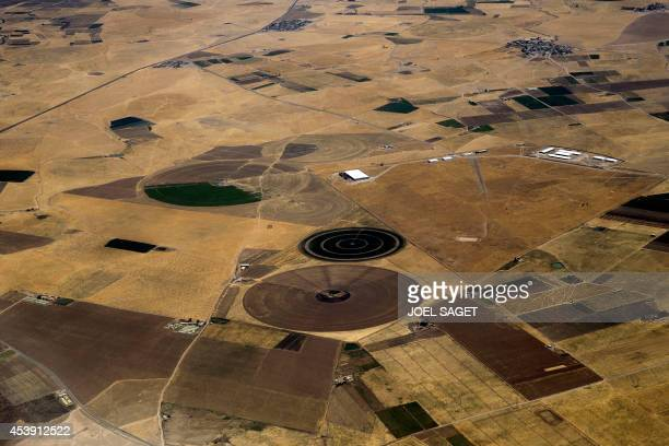 An aerial view shows circular fields with centre pivot irrigation system near Arbil in northern Iraq on August 21 2014 The United States sought to...