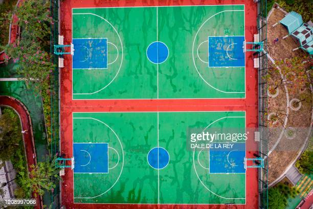 An aerial view shows closed public basketball courts in Hong Kong on March 30, 2020. - The government's Leisure and Cultural Services Department has...