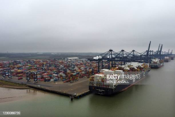 An aerial view shows container ships MSC Maria Saveria and MSC Maureen docked in the port of Felixstowe, east of London on December 12, 2020. - Food...