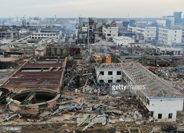 An aerial view shows damaged buildings after an explosion at a chemical plant in Yancheng in China's eastern Jiangsu province early on March 22 2019...