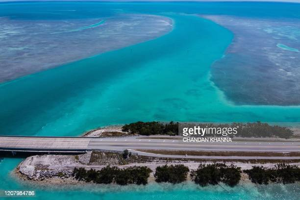 An aerial view shows deserted country road 905 in Key Largo some 70 miles south of Miami on March 22 during the coronavirus outbreak The Florida Keys...