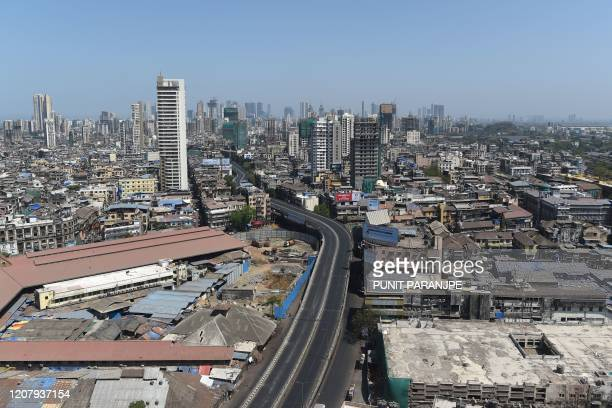 An aerial view shows deserted JJ bridge against the backdrop of city's skyline during a oneday Janata curfew imposed as a preventive measure against...