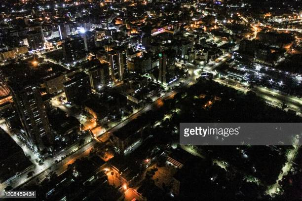 An aerial view shows empty streets in downtown Nairobi after the first day of the night curfew ordered by Kenyan President Uhuru Kenyatta to curb the...
