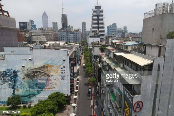 An aerial view shows empty streets next to the Taipei Cinema Park in the Wanhua District, in Taipei on May 19, 2021.