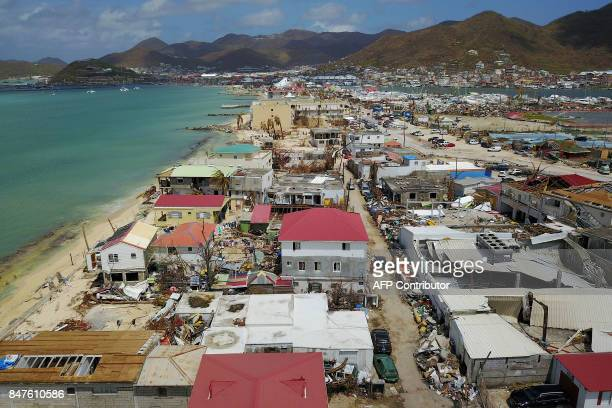 An aerial view shows extensive damage to houses and businesses in St. Martin, Friday, September 15 days after Hurricane Irma struck this Caribbean...