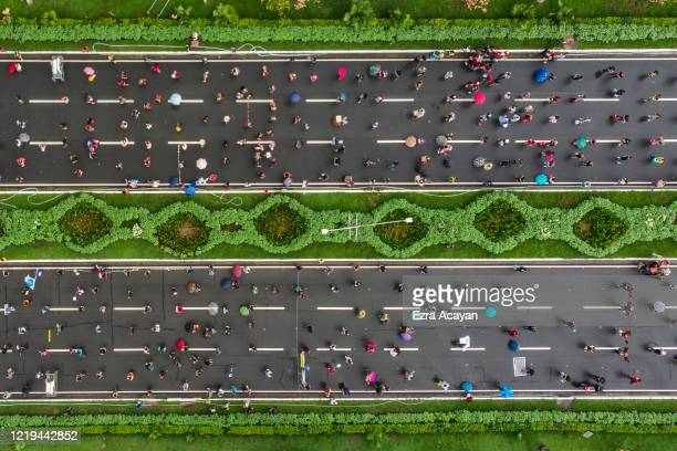 An aerial view shows Filipinos observing social distancing as they take part in a protest against President Duterte's Anti-Terror bill on June 12,...