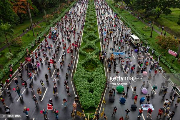 An aerial view shows Filipinos observing social distancing as they take part in a protest against President Duterte's AntiTerror bill on June 12 2020...