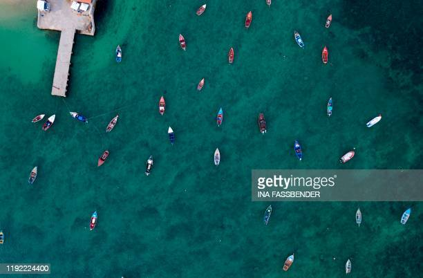 An aerial view shows fisher boats at the harbour in Sal Rei at Boa Vista island Cape Verde on January 06 2020