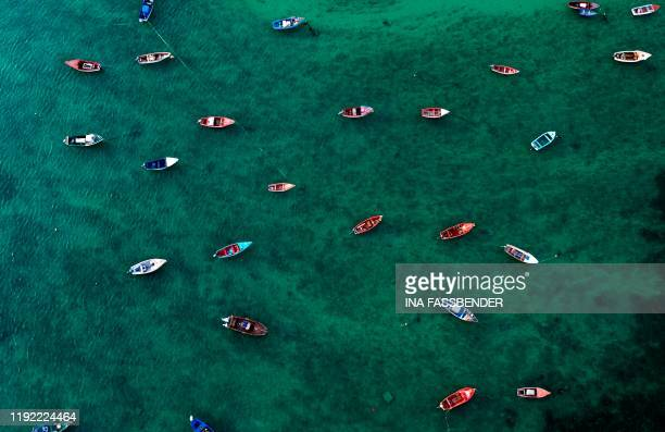 TOPSHOT An aerial view shows fisher boats at the harbour in Sal Rei at Boa Vista island Cape Verde on January 06 2020