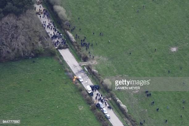 An aerial view shows gendarmes and protesters clashing on April 11 during a police operation to raze the decade-old anti-capitalist camp known as ZAD...