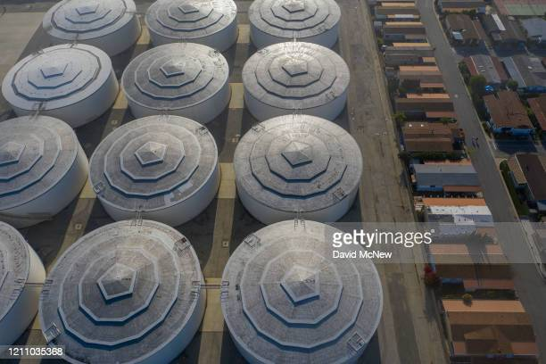 An aerial view shows homes near the Dominguez Hill Tank Farm Oil Storage Terminal as oil prices have cratered with the spread of the coronavirus...
