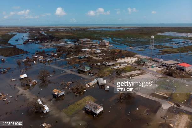 An aerial view shows homes that were destroyed by Hurricane Laura on August 29, 2020 in Cameron, Louisiana. - At least 14 people were killed after...