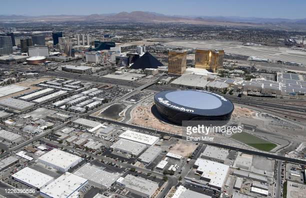 An aerial view shows hotelcasinos on the Las Vegas Strip east of the construction continuing at Allegiant Stadium the USD 2 billion glassdomed home...
