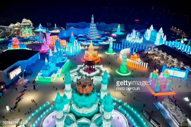 TOPSHOT An aerial view shows ice sculptures during the annual Harbin Ice and Snow Festival in Harbin in China's northeast Heilongjiang province on...