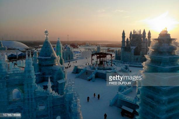 An aerial view shows ice sculptures during the annual Harbin Ice and Snow Festival in Harbin in China's northeast Heilongjiang province on January 7...