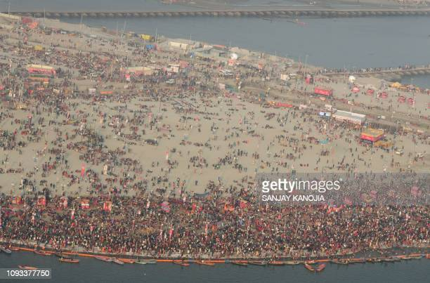 An aerial view shows Indian Hindu pilgrims arrive at the Sangam -- the confluence of the Rivers Ganges, Yamuna and mythical Saraswati on eve of the...