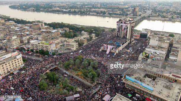 An aerial view shows Iraqi protesters gathering at Baghdad's Tahrir square near al-Jumhuriya bridge which leads to the high-security Green Zone...