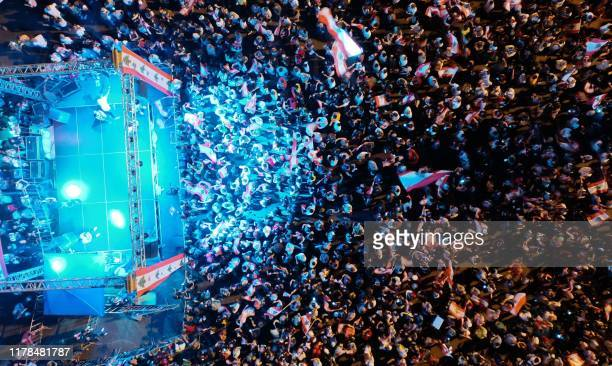 An aerial view shows Lebanese demonstrators attending gathered at Martyrs' Square in the centre of the capital Beirut on October 27 during ongoing...