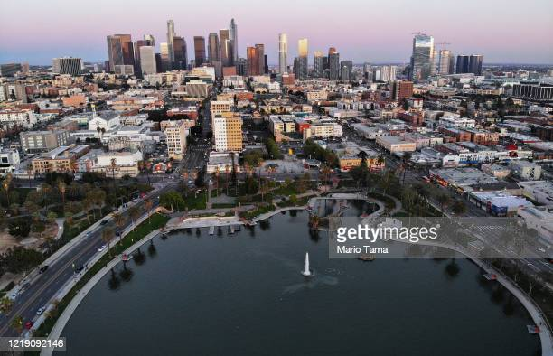 An aerial view shows MacArthur Park and downtown in the midst of the coronavirus pandemic on April 15 2020 in Los Angeles California Environmental...