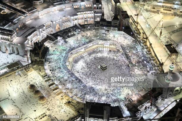 An aerial view shows Muslim pilgrims circumambulating the Kaaba Islam's holiest shrine at the Grand Mosque in Saudi Arabia's holy city of Mecca on...