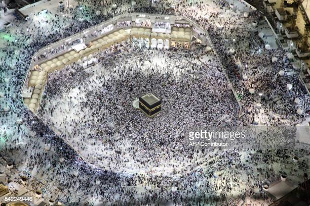 TOPSHOT An aerial view shows Muslim pilgrims circumambulating the Kaaba Islam's holiest shrine at the Grand Mosque in Saudi Arabia's holy city of...