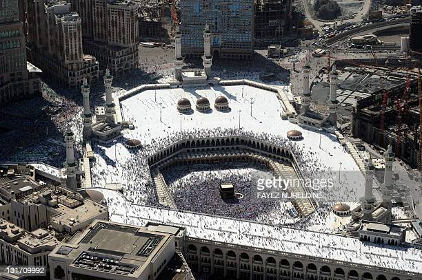 An aerial view shows Muslim pilgrims walking around the Kaaba in the Grand Mosque of the holy city of Mecca during the annual Hajj pilgrimage rituals...
