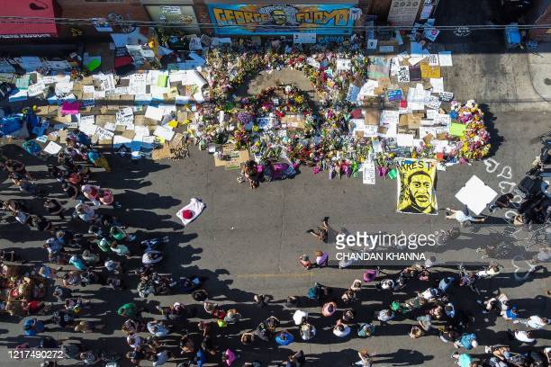 An aerial view shows people gathering to pay tribute at a makeshift memorial in honour of George Floyd, on June 3, 2020 in Minneapolis, Minnesota. -...