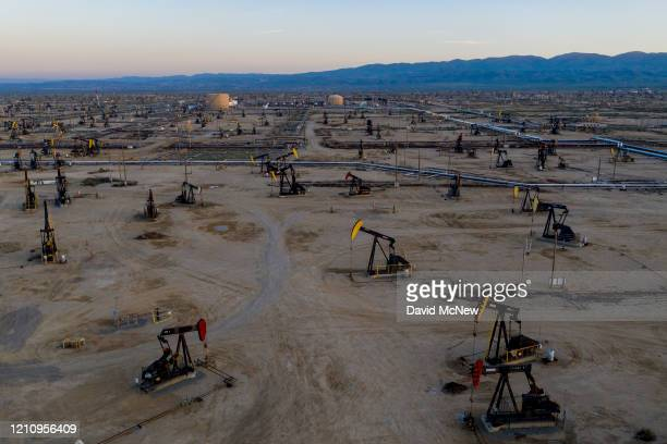 An aerial view shows pumpjacks in the South Belridge Oil Field as oil prices have cratered with the spread of the coronavirus pandemic on April 24,...