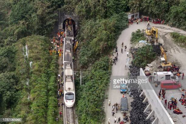 An aerial view shows rescue workers at the site where a train derailed inside a tunnel in the mountains of Hualien, eastern Taiwan on April 2, 2021.