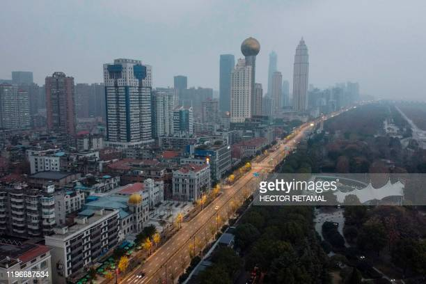 TOPSHOT An aerial view shows residential and commercial buildings of Wuhan in China's central Hubei province on January 27 amid a deadly virus...