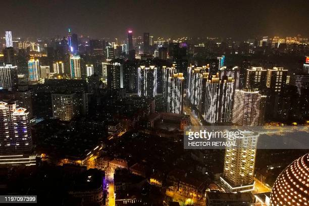 An aerial view shows residential and commercial buildings of Wuhan in China's central Hubei province on January 27 amid a deadly virus outbreak which...