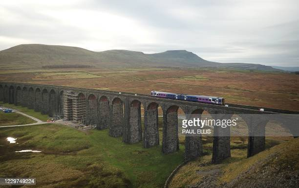 An aerial view shows scaffolding being erected ahead of planned restoration work on the Ribblehead Viaduct, near Settle, northwest England on...