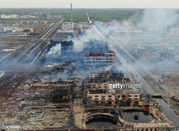 An aerial view shows smoke rising following an explosion at a chemical plant in Yancheng in China's eastern Jiangsu province early on March 22 2019...