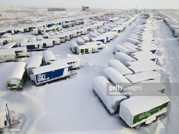 An aerial view shows snow and ice covered heavy equipment that have been parked for a long time at a construction site in coal-mining town Vorkuta,...