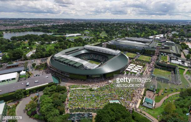 An aerial view shows spectators watching the big screen on the outside of No.1 Court on the seventh day of the 2021 Wimbledon Championships at The...