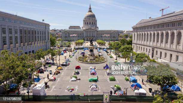 An aerial view shows squares painted on the ground to encourage homeless people to keep to social distancing at a city-sanctioned homeless encampment...