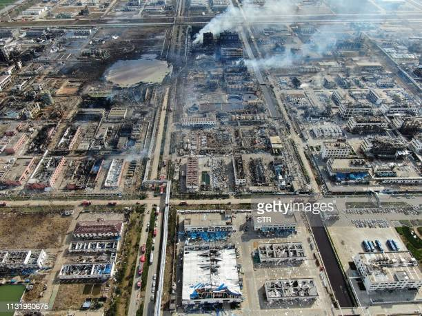 An aerial view shows the aftermath of an explosion at a chemical plant in Yancheng in China's eastern Jiangsu province early on March 22 2019 Chinese...