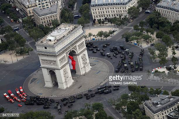 An aerial view shows the Arc de Triomphe during the annual Bastille Day military parade on the ChampsElysees avenue in Paris on July 14 2016 France...