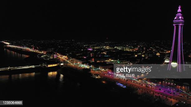 An aerial view shows the Blackpool Tower and the annual illuminations in Blackpool, north west England on September 4, 2021 - For the second year...