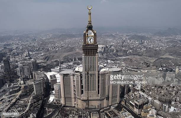 An aerial view shows the clock of the Abraj AlBait Towers in the holy city of Mecca on October 5 2014 Saudi Arabia said that around 2 millions...
