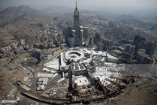 An aerial view shows the Clock Tower and the Grand Mosque in Saudi Arabia's holy Muslim city of Mecca on September 13 2016 More than 18 million...