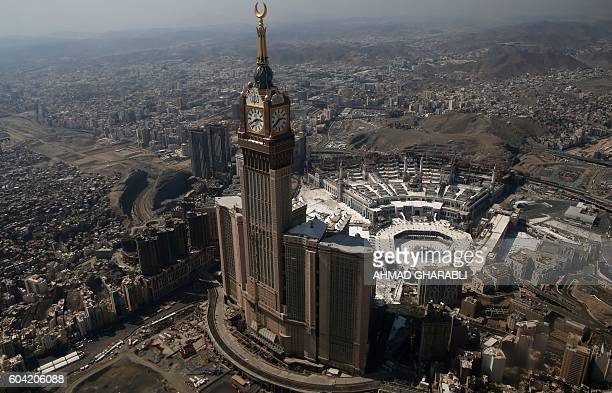 TOPSHOT An aerial view shows the Clock Tower and the Grand Mosque in Saudi Arabia's holy Muslim city of Mecca on September 13 2016 More than 18...