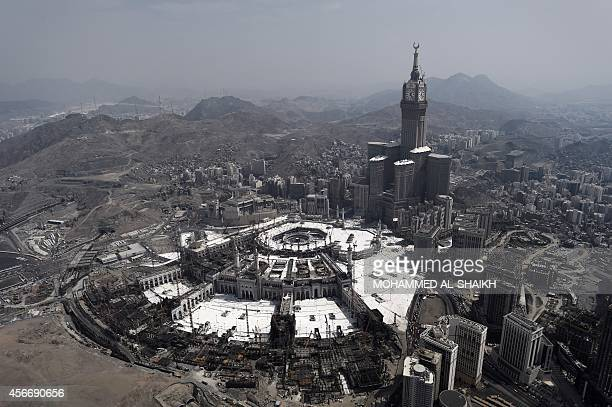 An aerial view shows the Clock Tower and the Grand Mosque in the holy city of Mecca on October 5 2014 Saudi Arabia said that around 2 millions...