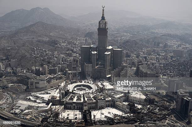 An aerial view shows the Clock Tower and the Grand Mosque in the Saudi holy city of Mecca on September 25 2015 AFP PHOTO / MOHAMMED ALSHAIKH