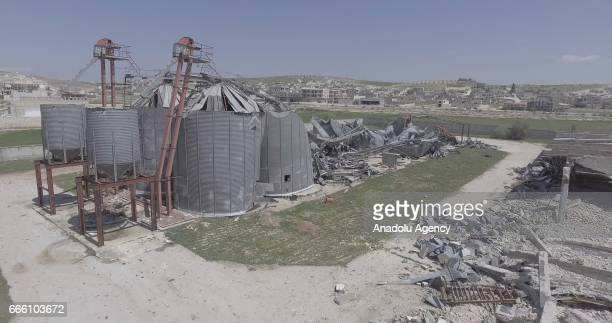 An aerial view shows the damaged cereals silo located nearby 50 meters to residential area in Khan Shaykhun town of Idlib after Assad Regime's...